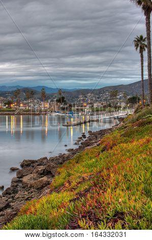Overcast sky reflected in Ventura Marina water at dusk.
