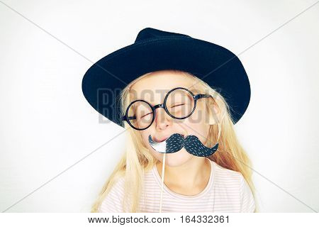 Laughing Little Girl With Fake Black Moustache