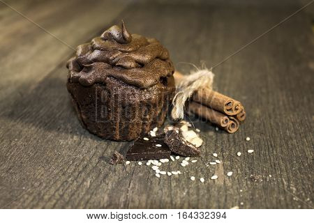 A cupcake is a small cake designed to serve one person which may be baked in a small thin paper or aluminum cup. As with larger cakes icing and other cake decorations such as candy may be applied.