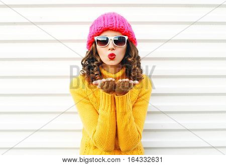 Fashion Portrait Woman Blowing Red Lips Makes Sends Air Kiss Wearing Colorful Knitted Hat Over White