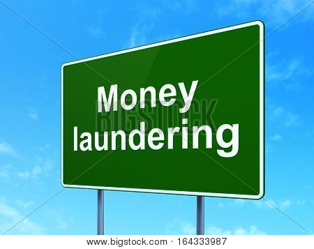 Money concept: Money Laundering on green road highway sign, clear blue sky background, 3D rendering