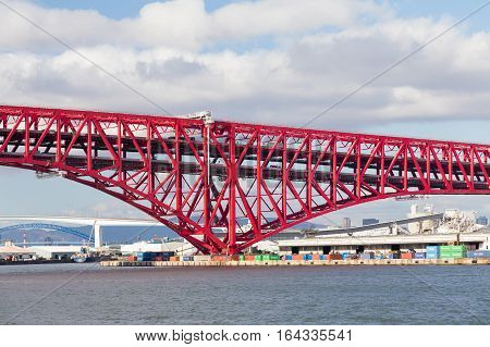 Minato Bridge (red bridged) in Osaka port Japan