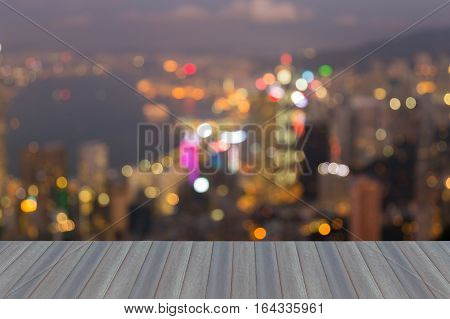 Opening wooden floor Hong Kong city blurred lights night view over Victoria Bay abstract background