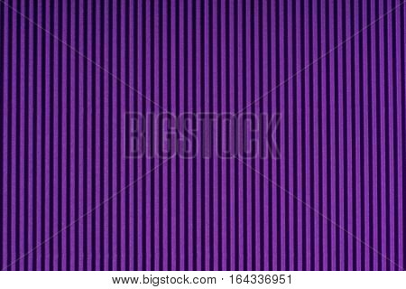 Striped embossed purple paper. Colored paper. Violet color texture background.