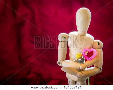 Still Life Wooden Puppet And Pink Heart.