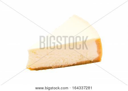Slice of new york cheesecake isolated on white background. Sweet Dessert close up.