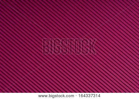 Striped magenta embossed paper. Colored paper. Red wine color texture background