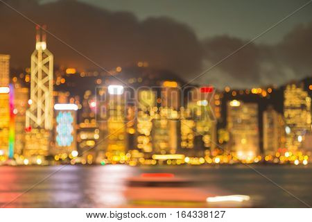 Night blurred lights Hong Kong city downtown sea front abstract background