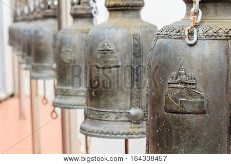 Closeup Row Of Bells In Buddhist Temple In Thailand.