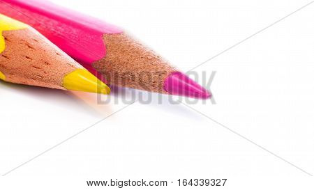 Closeup Of Yelow And Pink Pencils On A White Background - Copy Space