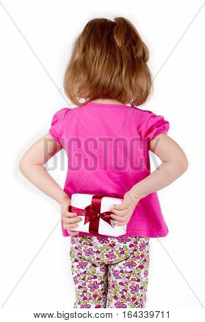 little girl child hid behind a gift