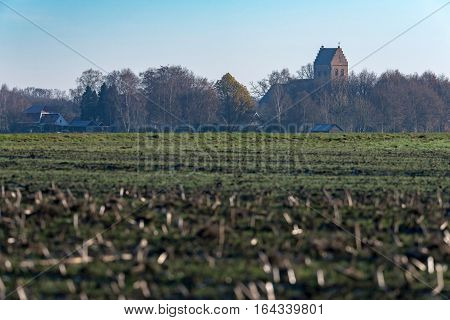 Farmland In Winter With Ancient Churchtower At The Horizon. Geesteren. Achterhoek. Gelderland. The N