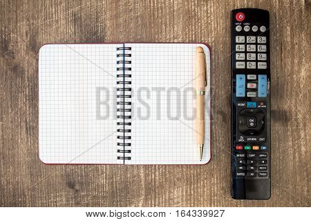 Tv remote control and blank notebook for copy-space