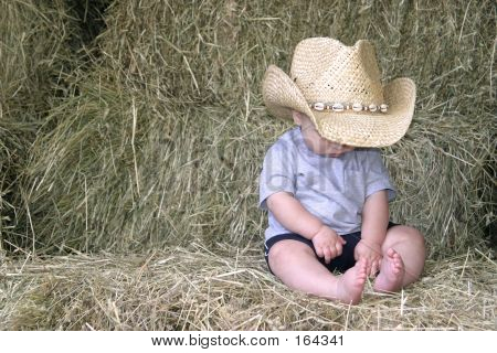 Baby Cowboy In The Hay