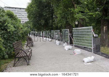 Alley in a park with benches and fencing repairs