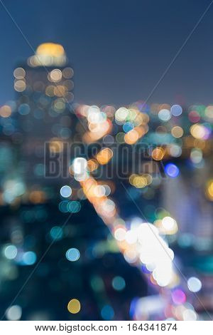 Blurred city lights downtown building night view abstract background