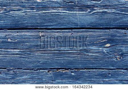 Blue Toned Weathered Log House Surface.