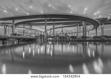Black and White Round about highway interchanged overpass with moving cloud background