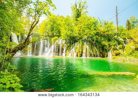 Beautiful landscape, waterfall and clear green water in Plitvice Lakes National Park Croatia