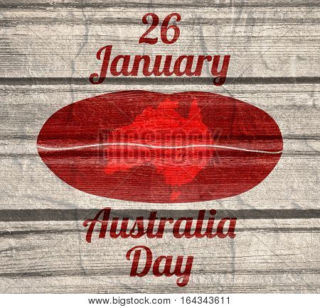 Map of Australia printed on woman lips. 26 January Australia Day text. Wood texture