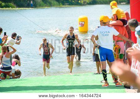Triathlon Cup of Ukraine and Cup of Bila Tserkva. July 24 2016 in Bila Tserkva Ukraine. Swimmers athlete completes the race