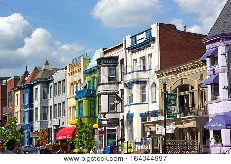 WASHINGTON DC USA - MAY 9: Colorful historic buildings in Adams Morgan neighborhood on May 9 2015 in Washington DC. Vibrant city street offers menu variety and musical entertainment at bars and restaurants.