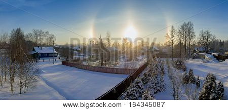 Halo effect of sun in Moscow region, Russia. Winter landscape.