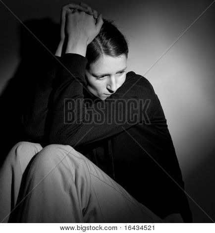 Young woman suffering from severe depression