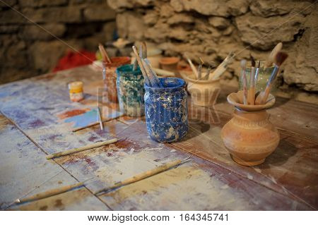 tools for painting pottery in the studio