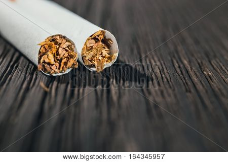 Cigarette Left On The Brown Wooden Table, Close Up With Copy Space