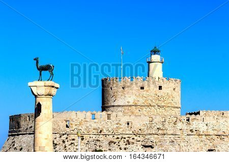 The imposing St. Nicholas Fortress is located in the Rhodes Old Town looking out over Mandraki Harbor, Greece