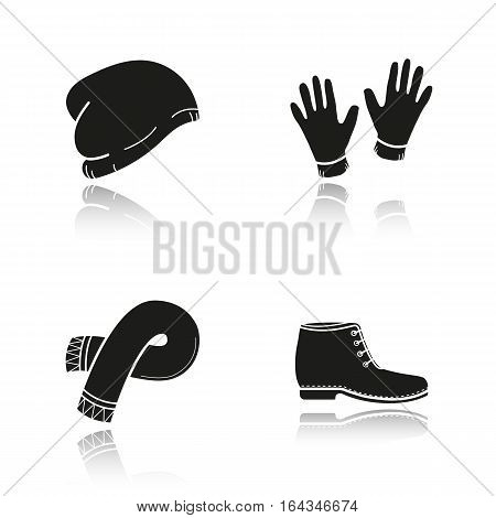Winter clothes drop shadow black icons set. Ski hat, gloves, scarf, boot. Isolated vector illustrations