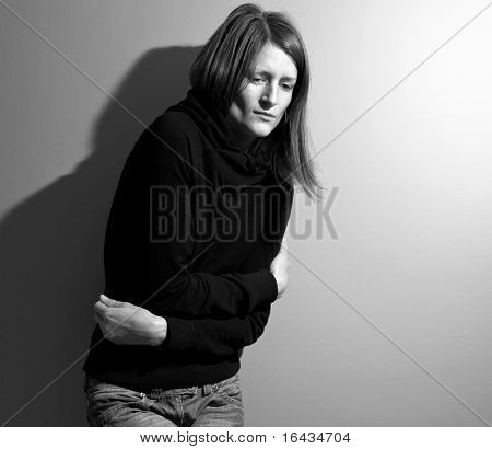 Young woman suffering from a severe stomach pain/depression/anxiety