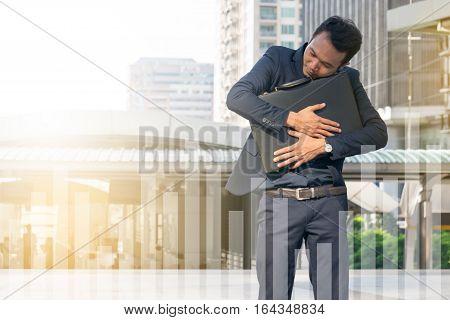 businessman hugging a briefcase , powerful businessman