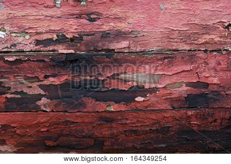 Chipped Red Paint on Old Wood Background