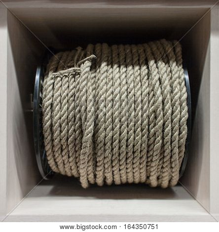 A reel of gray rope. Close up view