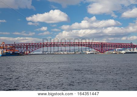 Minato Bridge over seacoast skyline and blue sky background in Osaka Japan