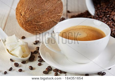 Bulletproof Coffee And Coconut On Table