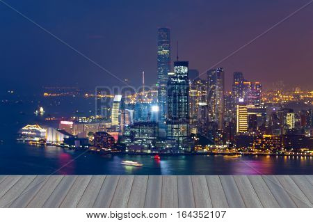 Opening wooden floor Aerial view blrred lights Hong Kong city business downtown abstract background