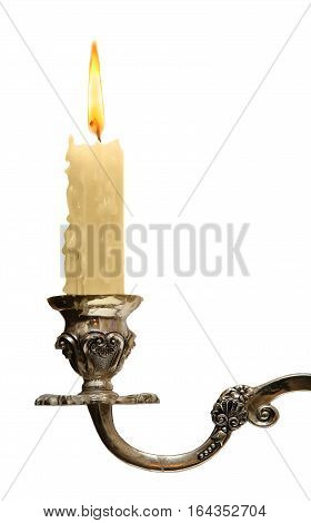 burning old candle vintage bronze candlestick. Isolated On a White Background.
