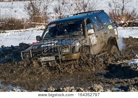 Lviv Ukraine - December 04 2016: Off-road vehicle brand Toyota overcomes the track on a amateur competitions Trial near the city Lviv Ukraine