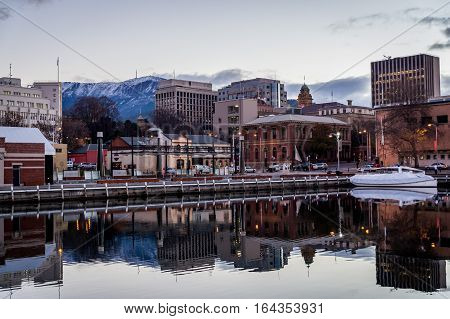 Waterfront in wintertime in Hobart, Tasmania, Australia with Mt. Wellington covered in snow