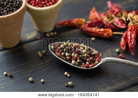 Red hot chili cayenne peppers dried variety - spicy ingredient in old tin spoon