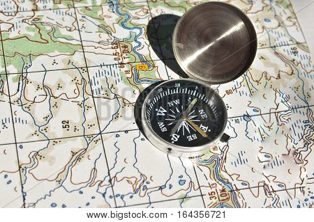 Symbols of travel - map with compass. Navigation tools for planning and guidance.