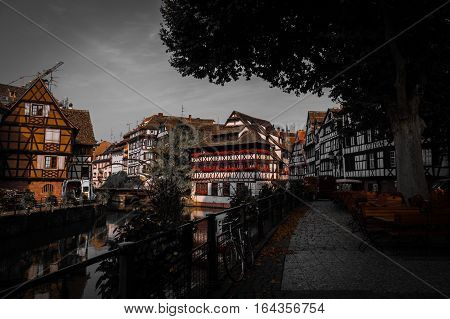 Historic old town half-timber houses on street at river Ill in Petite France district in Strassburg, Alsace, France