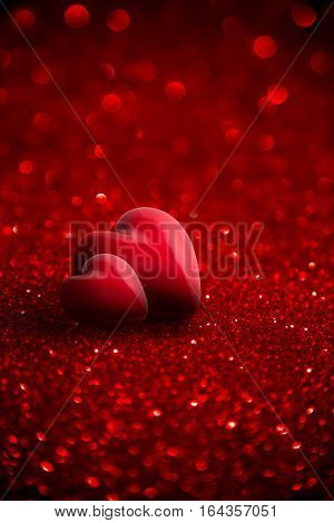 two red hearts with glitter for background of Valentine day