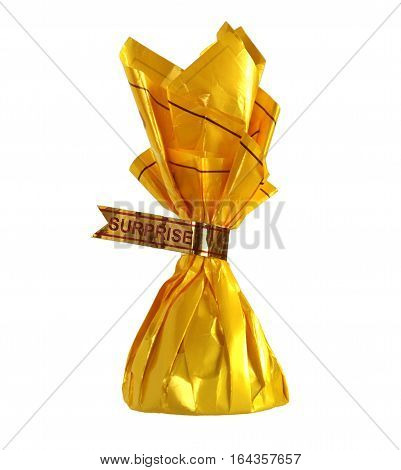 Yellow candy wrapper with word Surprise as a concept of pleasant surprises