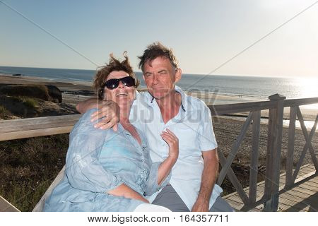 A Retired Senior Couple Enjoy A Holiday In The Evening Sun