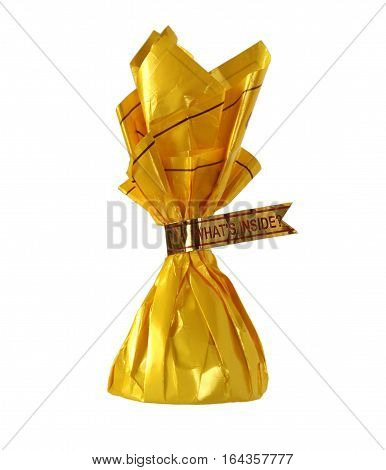 Yellow candy wrapper with words What is inside as a concept of pleasant surprises