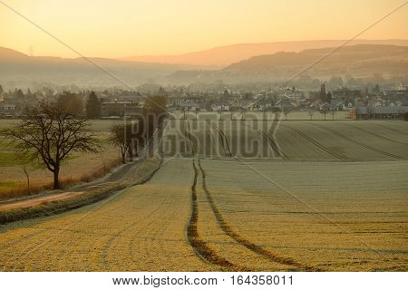 Agricultural fields and the town on the sunrise. Bad Pyrmont Lower Saxony Germany.